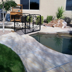 Stone decking and Turf around Koi Pond
